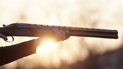 Woman training with a shotgun at sunset Stock Footage