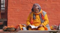 Hindu priests reading book,Patan,Nepal - stock footage