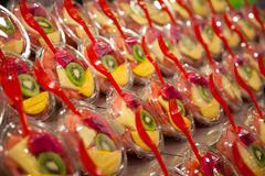 Variety of fruit salad in La Boqueria market, Barcelona. Stock Photos