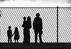 Silhouette family standing in front of fence - stock illustration