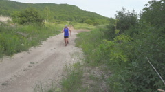 Slow motion. Man run on camera. Male runner exercising and training outdoors Stock Footage