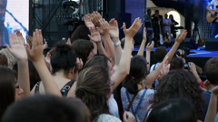 Crowd people cheerfully clapping hands - spectators on a music concert - stock footage