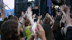 Crowd people cheerfully clapping hands - spectators on a music concert Stock Footage