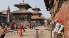 Nepali men watching crowds on Durbar square,Patan,Nepal Stock Footage