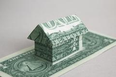 House made of one dollar US notes against white background Stock Illustration