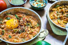 Turkish food Menemen in copper pan Stock Photos