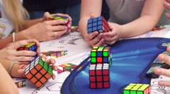 MOSCOW, RUSSIA - JUNE 19, 2016: People learn solving a Rubik's Cube puzzle on - stock footage