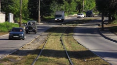 Tram rails. On both sides of the road moving vehicles. Stock Footage