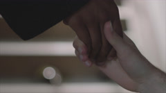 Interracial friends holding hands - stock footage