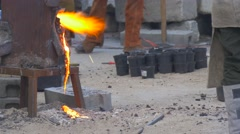 Molten Iron Flows Directly on the Sand Stock Footage