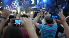 Shooting video of concert performance via smart phone staying in crowd by stage Stock Footage