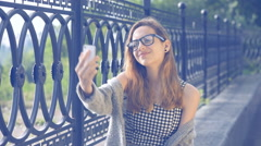 Happy girl taking self-portrait photo . Stock Footage