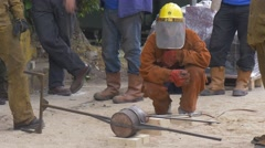 Big Group of Workers is Engaged in an Iron Meltdown Stock Footage