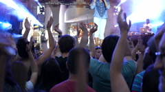 Crowd people fan spectators raise clapping hands in air enjoy music concert Stock Footage