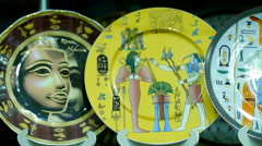 Egyptian souvenirs plates in the shop - stock footage