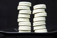 Stacks of cookies on plate Stock Photos