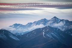Fog rolling over mountaintops - stock photo