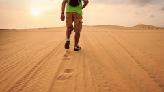 Tourist Leaves Footsteps on Tracks in White Sand Dunes - stock footage