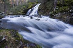 Time lapse view of rocky creek - stock photo