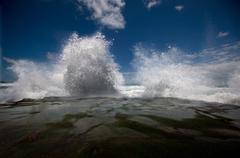Waves crashing on beach Stock Photos