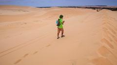 Old Man Makes Selfie on Crest against White Sand Dune Landscape Stock Footage