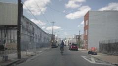 Philadelphia Biker On Street Shot From Car - stock footage