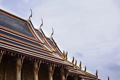 Decorations on ornate temple roof - stock photo