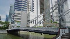 Cavenagh Bridge across the Singapore River Stock Footage