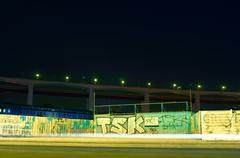 Time lapse view of traffic and graffiti Kuvituskuvat