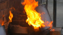 Male Hand Opens the Furnace Puts a Piece of Wood Furnace For Clay and Enamel Stock Footage