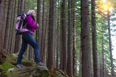 Inspired Female Hiker Staying on Stone in Forest Stock Photos