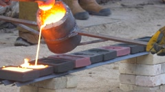 Workers Are Pouring Very Liquid Molten Metal Show For the Viewers the Iron is Stock Footage