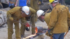 Three Men Poured Molten Iron in the Special Molds Stock Footage