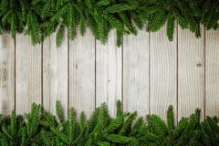 Christmas background -Fir tree on wooden table Kuvituskuvat