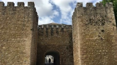 People walking through the gate at the Castelo dos Governadores - stock footage