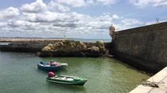 Boats next to the Forte da Ponta da Bandeira Stock Footage