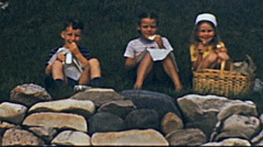 USA 1940's: children portrait while having a snack Stock Footage