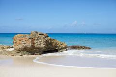 Rock formation on Anguilla beach - stock photo