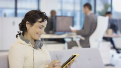 4K Portrait of smiling businesswoman using tablet computer in corporate office.  Stock Footage
