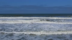View of tide with foamy surf Stock Footage