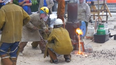Workers Pour the Fused Pig-Iron Into Furnace Stock Footage