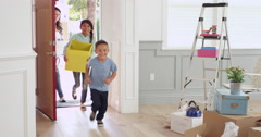 Hispanic Family Moving Into New Home Shot On R3D Stock Footage