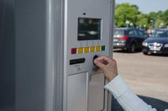 Paying in a parking automate - stock photo