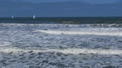 Yachts sailing in far distance - stock footage