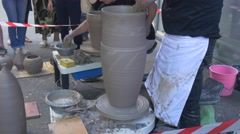 Employees of a Factory Compete Among Themselves in Speed of Creation of Clay - stock footage