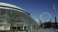 Tokyo Dome at Korakuen with ferries wheel Stock Footage