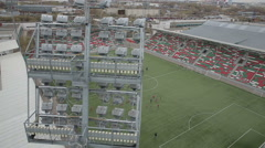 Children are trained on the football field, aerial view Stock Footage