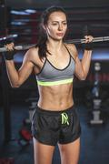 Young determined athlete lifting barbell in gym Stock Photos