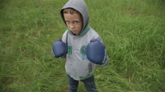 Funny boy in boxing gloves - stock footage