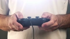 Man using game pad controller to play video games - stock footage